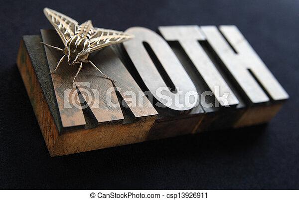 sphinx moth on old wood type word - csp13926911