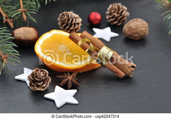spices and orange slices - csp42247314
