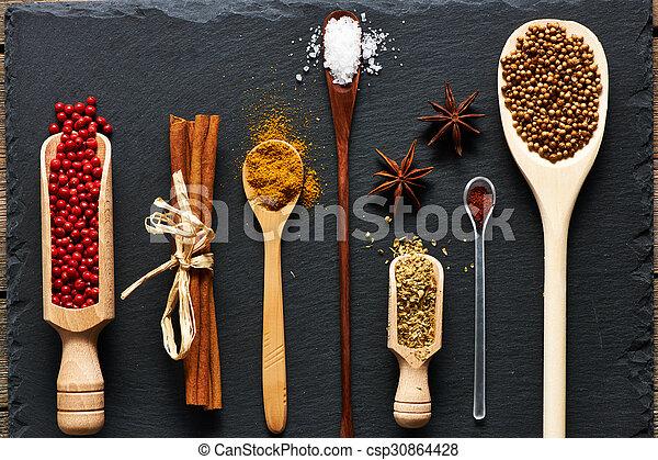 Spices in wooden utensils - csp30864428