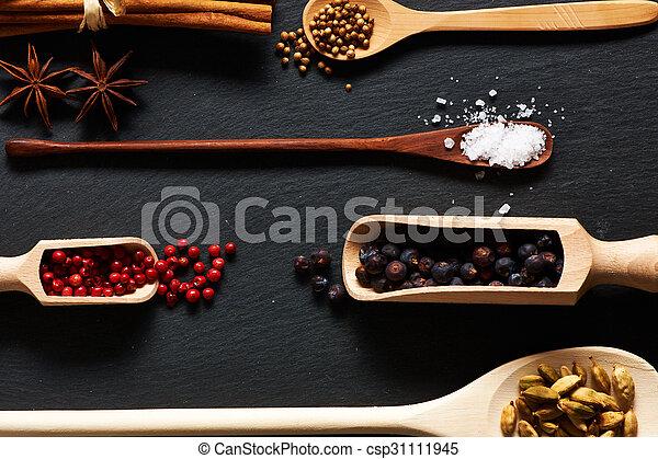 Spices in wooden utensils - csp31111945