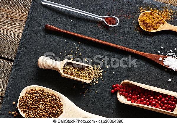 Spices in wooden utensils - csp30864390