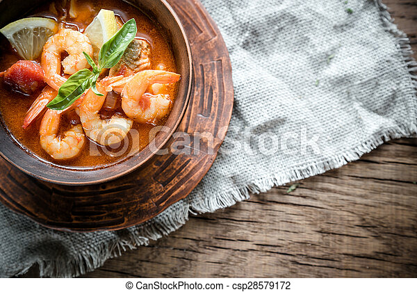 Spicy french soup with seafood - csp28579172