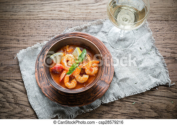 Spicy french soup with seafood - csp28579216