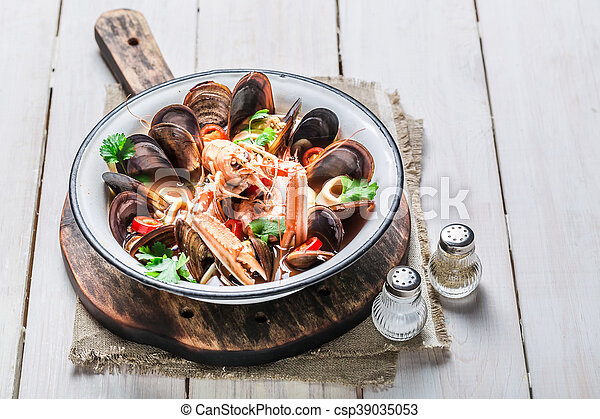 Spicy seafood soup with langoustines and mussels - csp39035053