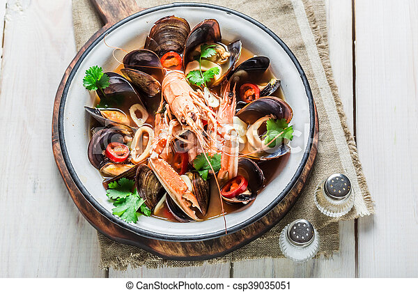 Spicy seafood soup with mix of shellfish - csp39035051