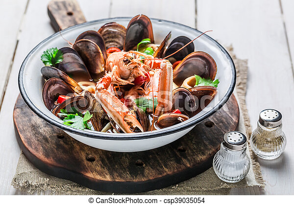 Spicy seafood soup with mussels and langoustines - csp39035054