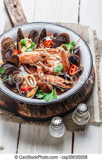 Spicy seafood soup with mussels and shrimps - csp39035058