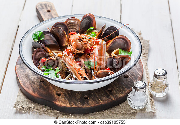 Spicy seafood soup with mussels and langoustines - csp39105755