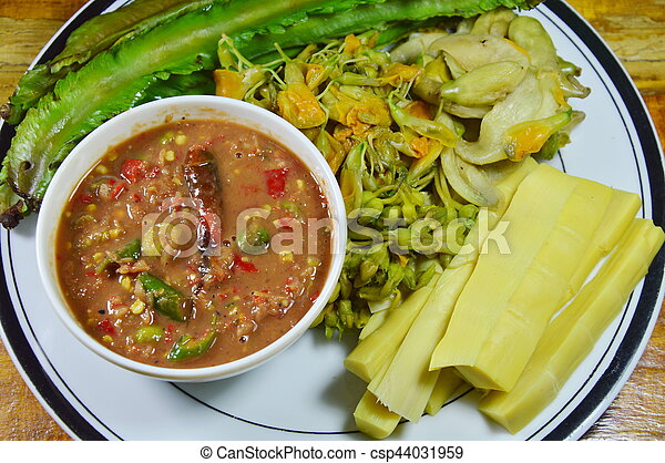 spicy shrimp paste sauce eat with mixed boiled vegetable on dish - csp44031959