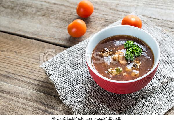 Spicy tomato soup with seafood - csp24608586
