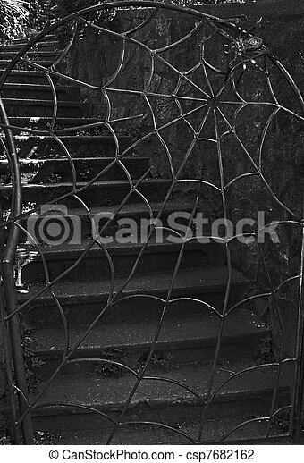 Spider and Web Iron Gate With Stairs - csp7682162