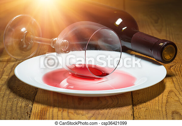 spilled glass of wine unfinished spilled wine on a white dish