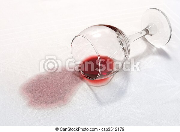spilled wineglass with a red spot on tablecloth