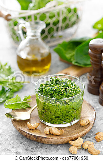 Spinach pesto sauce with cashew, parmesan cheese and olive oil - csp77061950