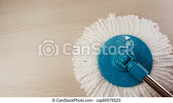 spinning mop with white microfiber on the floor - csp60576523