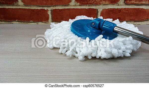 spinning mop with white microfiber on the floor - csp60576527