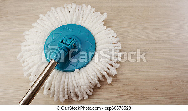 spinning mop with white microfiber on the floor - csp60576528