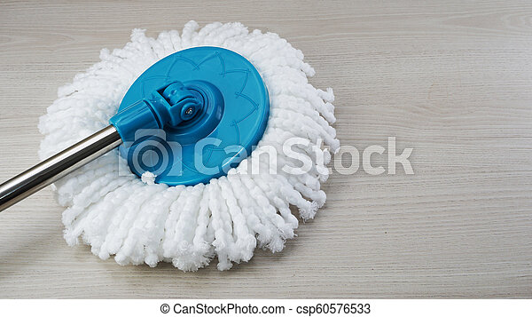 spinning mop with white microfiber on the floor - csp60576533