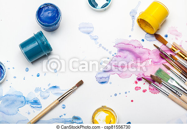 splashes of watercolor paint and painting supplies - csp81556730