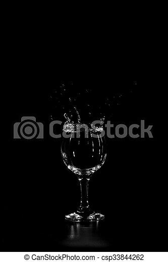 splashing in a glass - csp33844262
