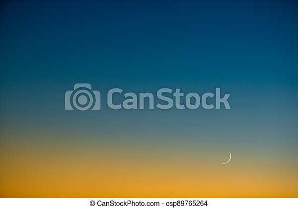 Splendid dusk/evening sky with the Moon - csp89765264