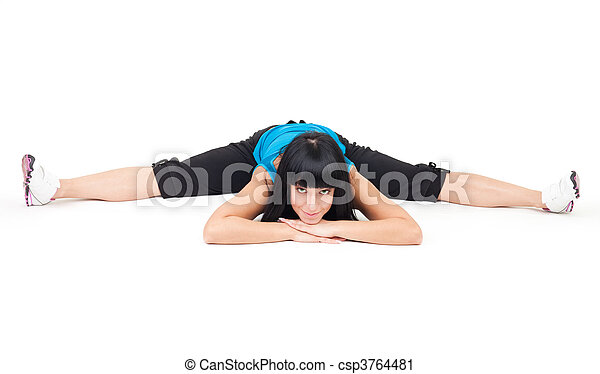 positive woman show splits exercise on the floor