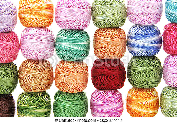 spools of many colors on a white background - csp2877447