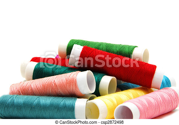 spools of many colors on a white background - csp2872498
