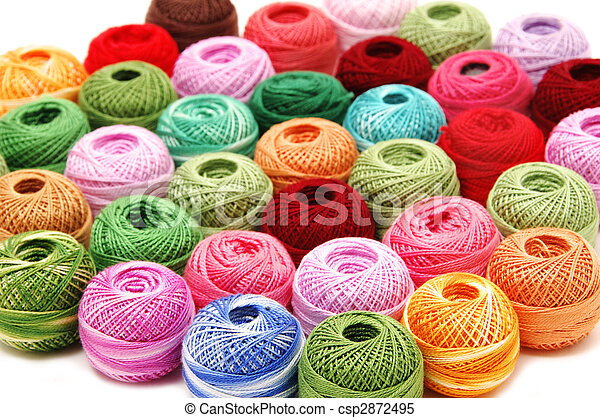 spools of many colors on a white background - csp2872495