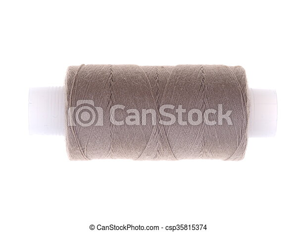 spools of thread on a white background - csp35815374