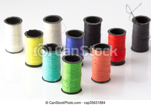spools of thread on a white background - csp35631884