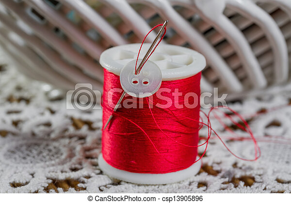 spools of thread on a wooden background - csp13905896