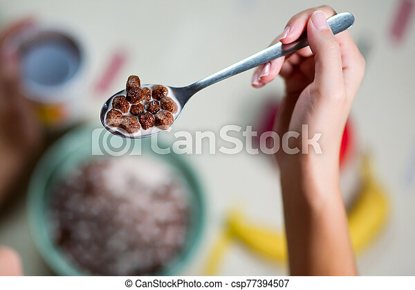 spoon with chocolate cereal close up - csp77394507