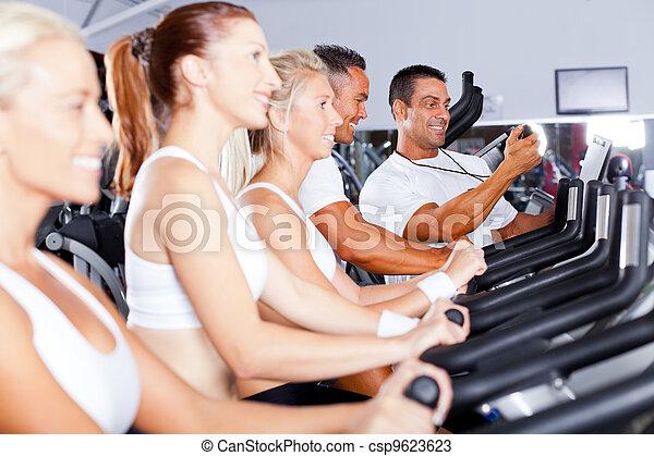 sport coach training cyclists in gym  - csp9623623