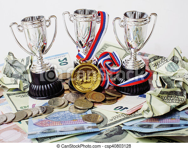 Sport winning concept: three cups among diverse currencies euro, dollar, rubl, gold medal first place - csp40803128