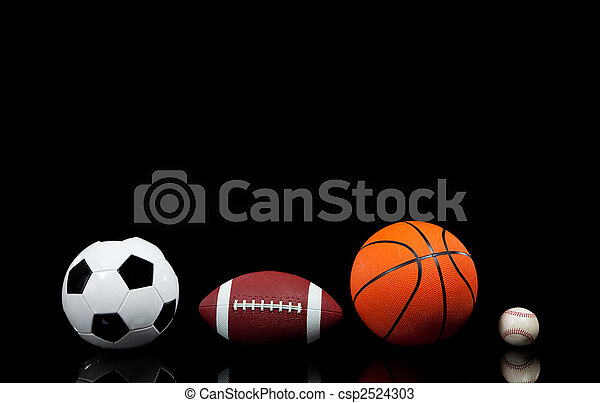 Sports balls on a black background - csp2524303