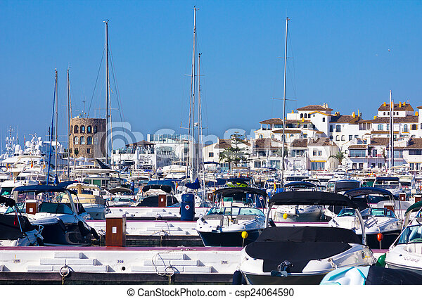 sports boats and yachts with the city of Puerto Banus in the bac - csp24064590
