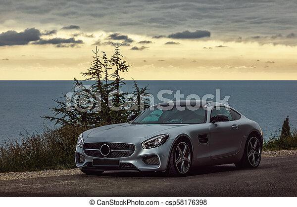 Sports car at sunset - csp58176398