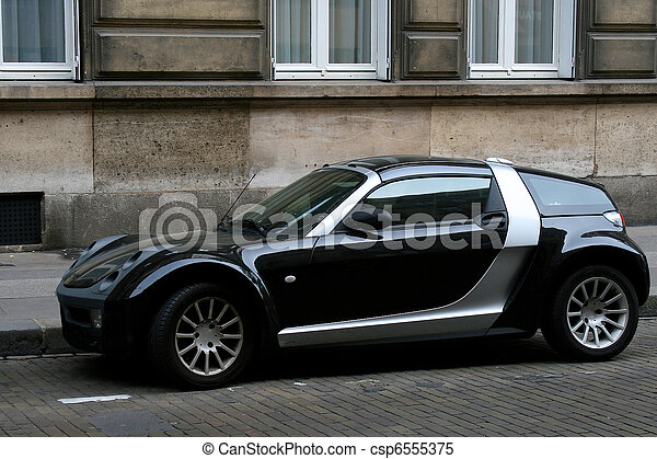 Sports Car A Modern Two Door Sports Car On A Cobble Stone Street