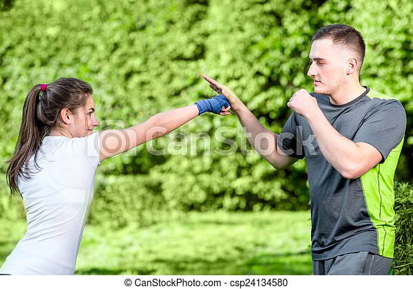 Sports couple in the park - csp24134580