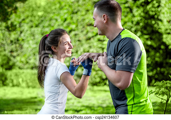 Sports couple in the park - csp24134607