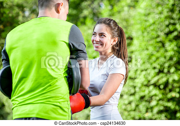 Sports couple in the park - csp24134630