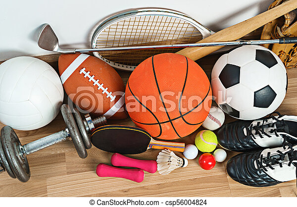 Sports Equipment on wooden background - csp56004824