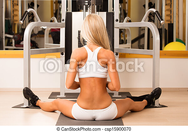 Sports young woman doing exercises in gym - csp15900070