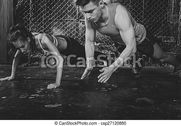 Sportsmen. fit male trainer man and woman doing clapping push-ups explosive strength training concept crossfit fitness workout strenght power - csp27120880