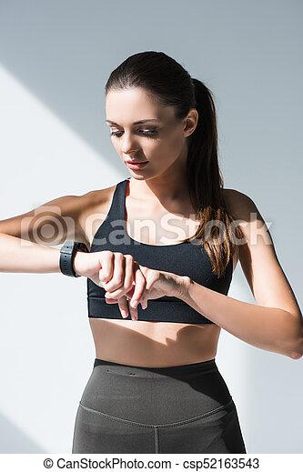 sportswoman using smartwatch - csp52163543