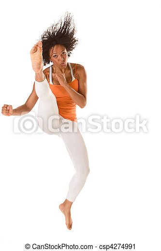 Sporty ethnic fitness woman jumping and kicking (motion blur) - csp4274991