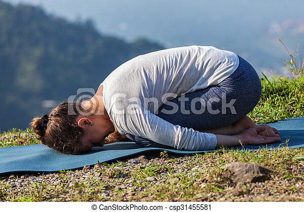 sporty fit woman practices yoga asana balasana  child