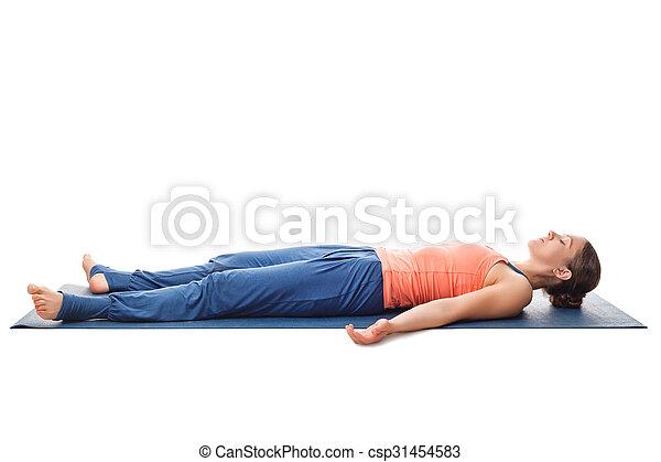sporty fit yogi girl relax in yoga asana savasana