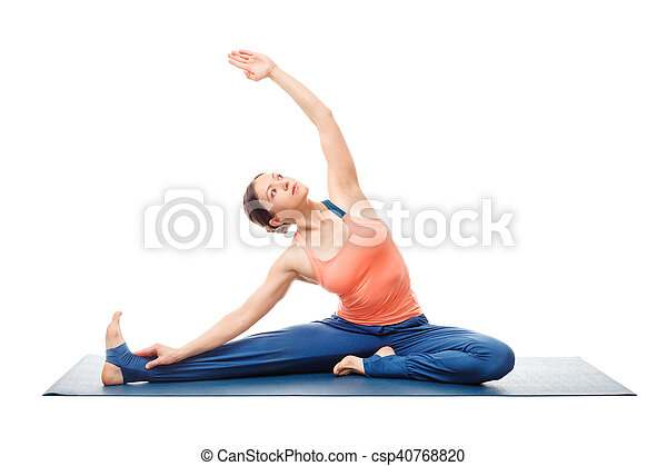 sporty fit yogini woman practices yoga asana parivrtta